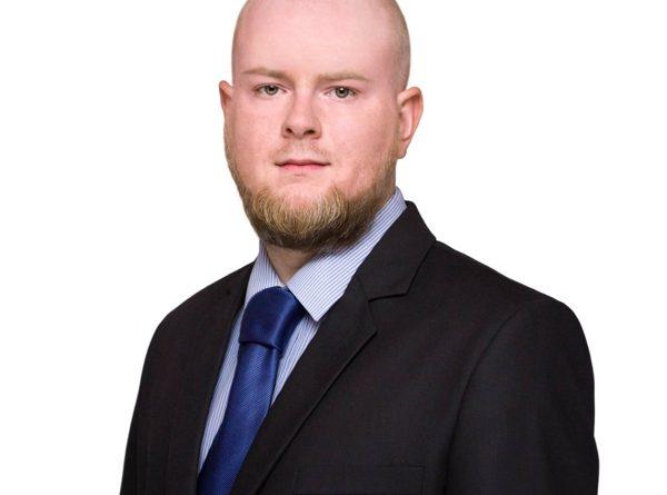 J.K.Adamczyk